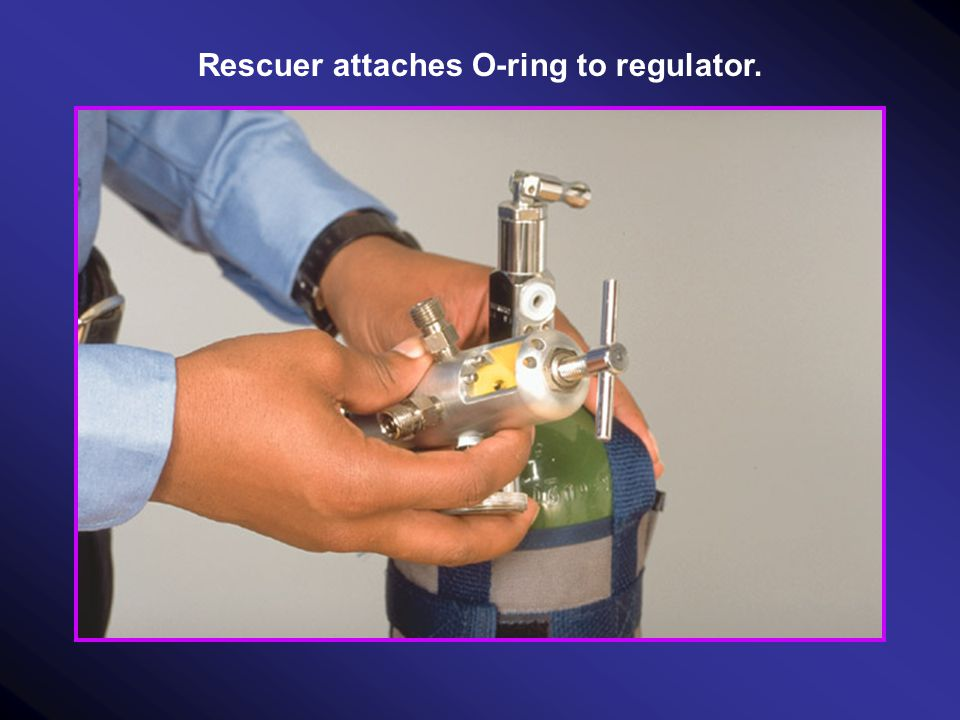 Rescuer attaches O-ring to regulator.