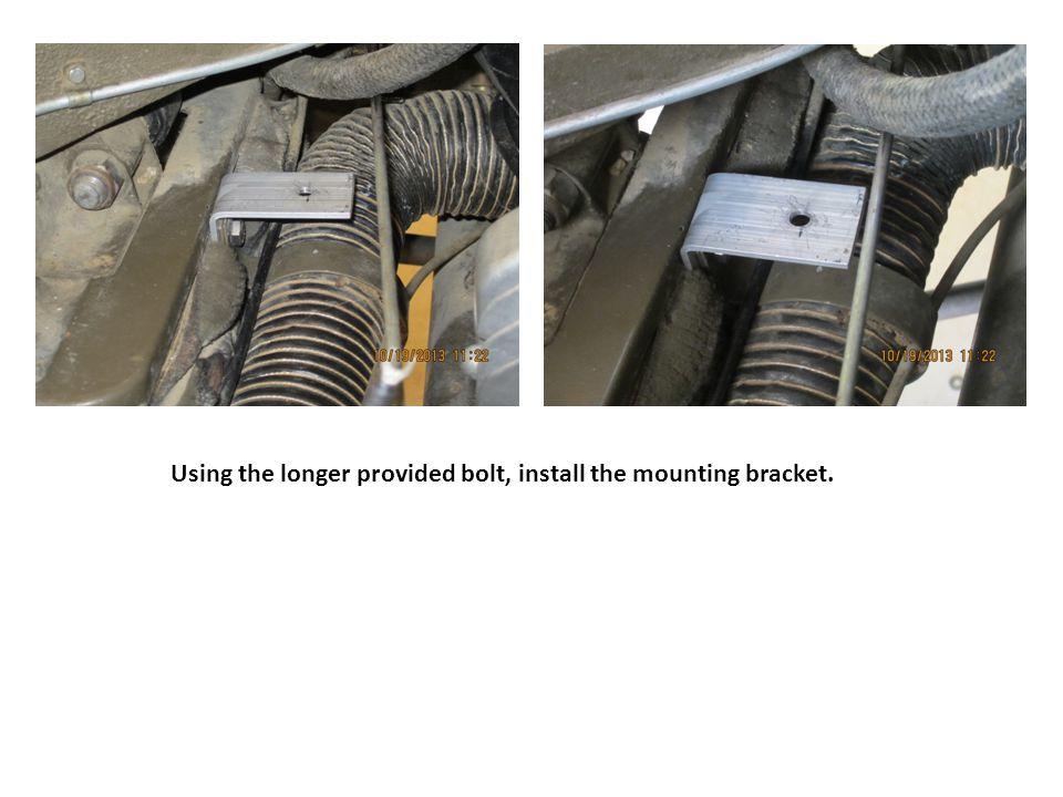 Using the longer provided bolt, install the mounting bracket.