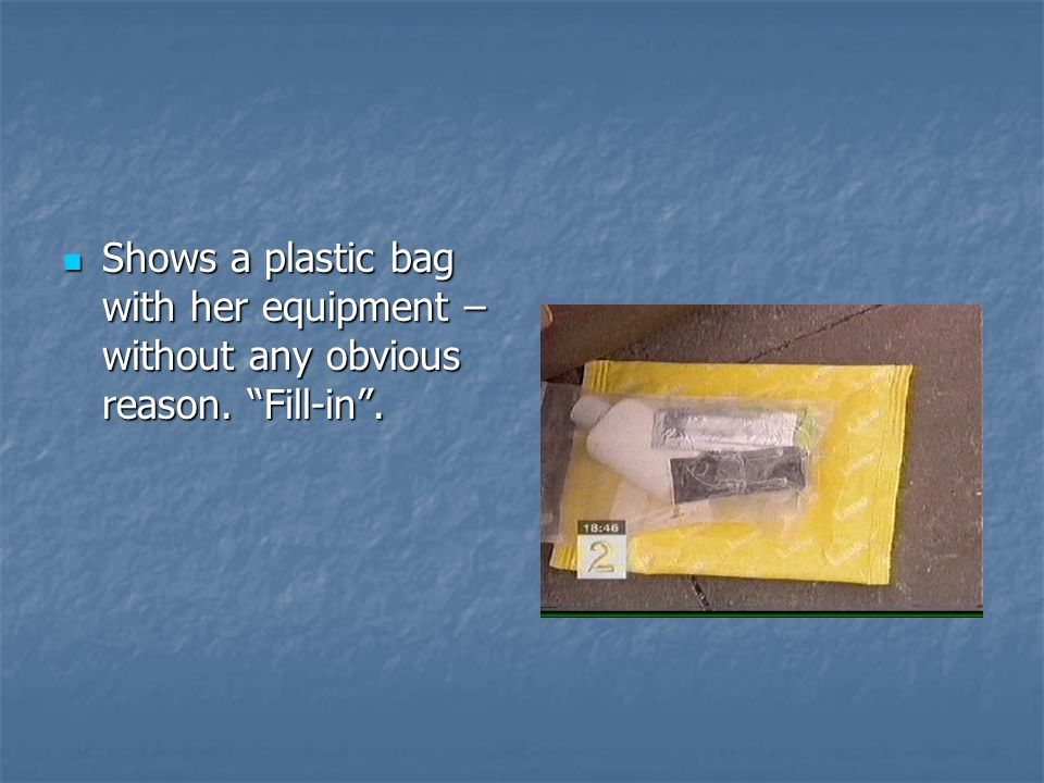 Shows a plastic bag with her equipment – without any obvious reason.