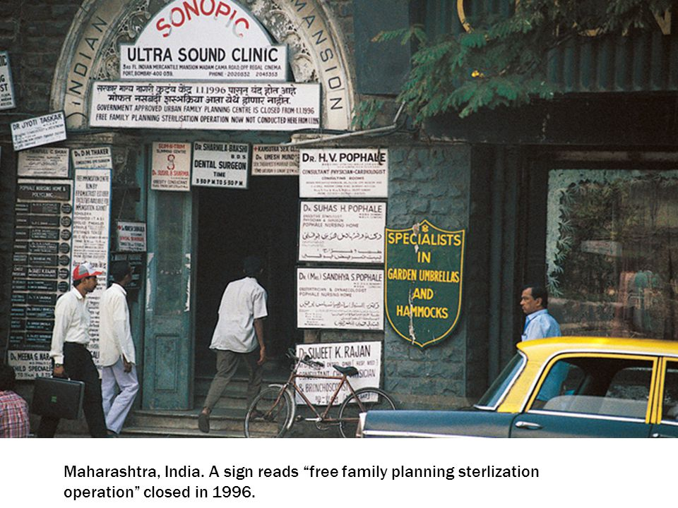 "Maharashtra, India. A sign reads ""free family planning sterlization operation"" closed in 1996."