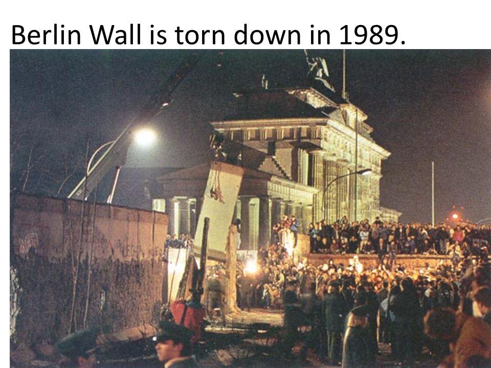 21 Berlin Wall is torn down in 1989.