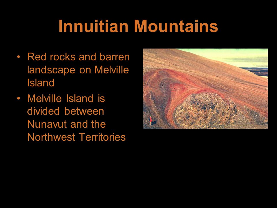 Innuitian Mountains Red rocks and barren landscape on Melville Island Melville Island is divided between Nunavut and the Northwest Territories