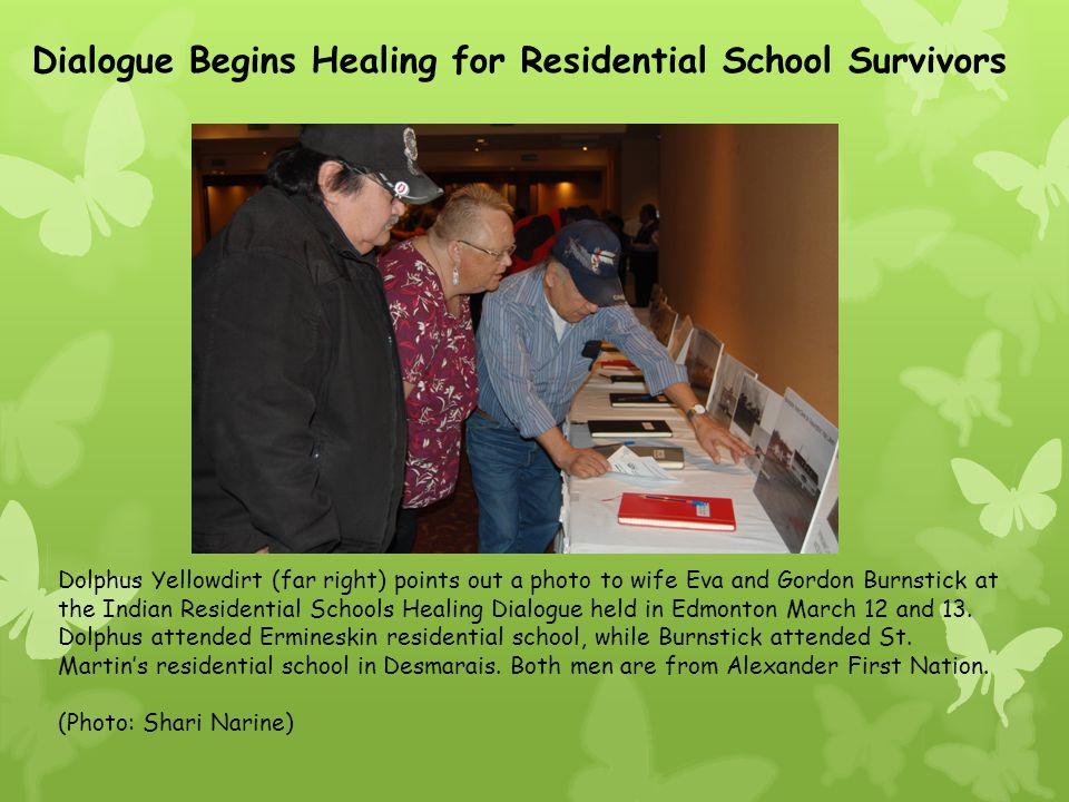 Dolphus Yellowdirt (far right) points out a photo to wife Eva and Gordon Burnstick at the Indian Residential Schools Healing Dialogue held in Edmonton March 12 and 13.