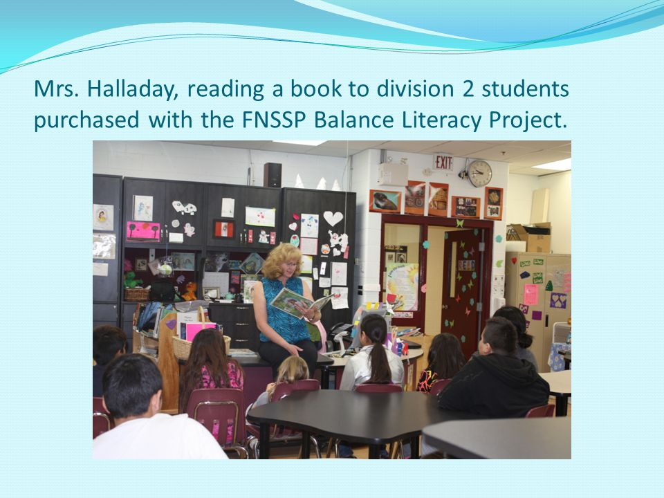 Mrs. Halladay, reading a book to division 2 students purchased with the FNSSP Balance Literacy Project.