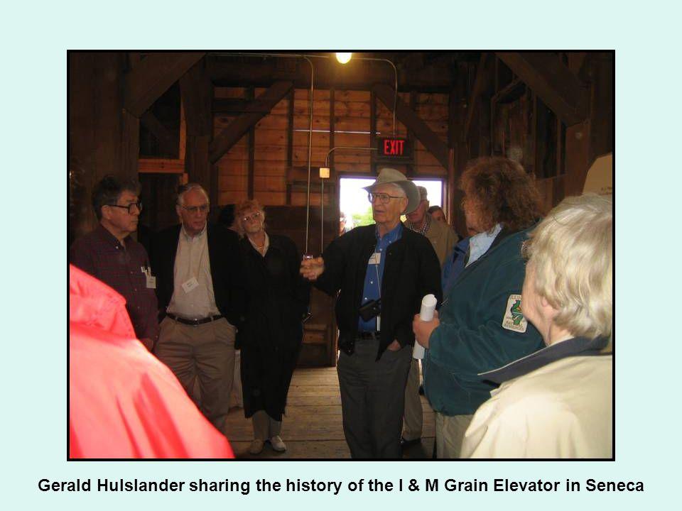 Gerald Hulslander sharing the history of the I & M Grain Elevator in Seneca