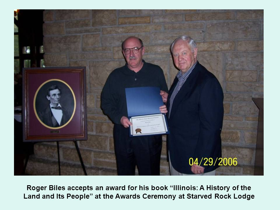 Roger Biles accepts an award for his book Illinois: A History of the Land and Its People at the Awards Ceremony at Starved Rock Lodge
