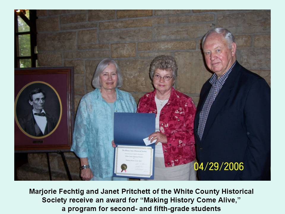 Marjorie Fechtig and Janet Pritchett of the White County Historical Society receive an award for Making History Come Alive, a program for second- and fifth-grade students
