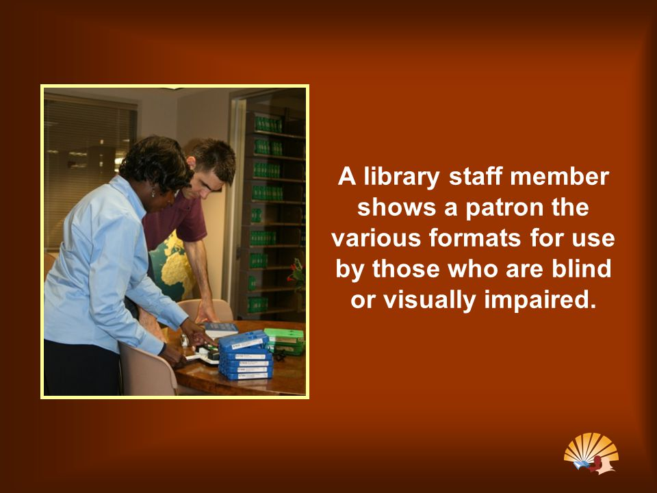 A library staff member shows a patron the various formats for use by those who are blind or visually impaired.
