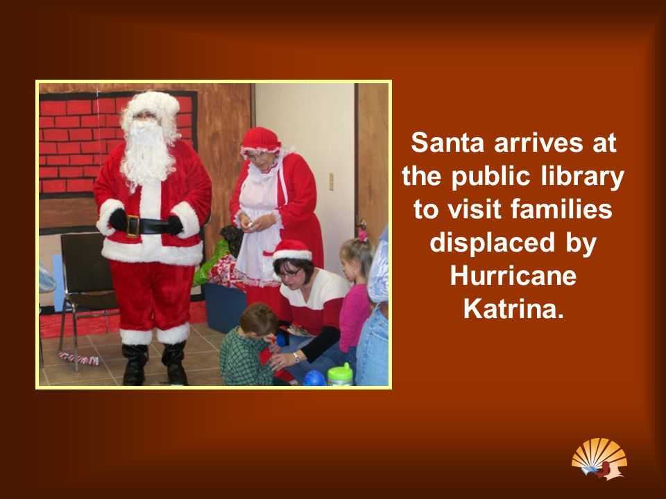 Santa arrives at the public library to visit families displaced by Hurricane Katrina.