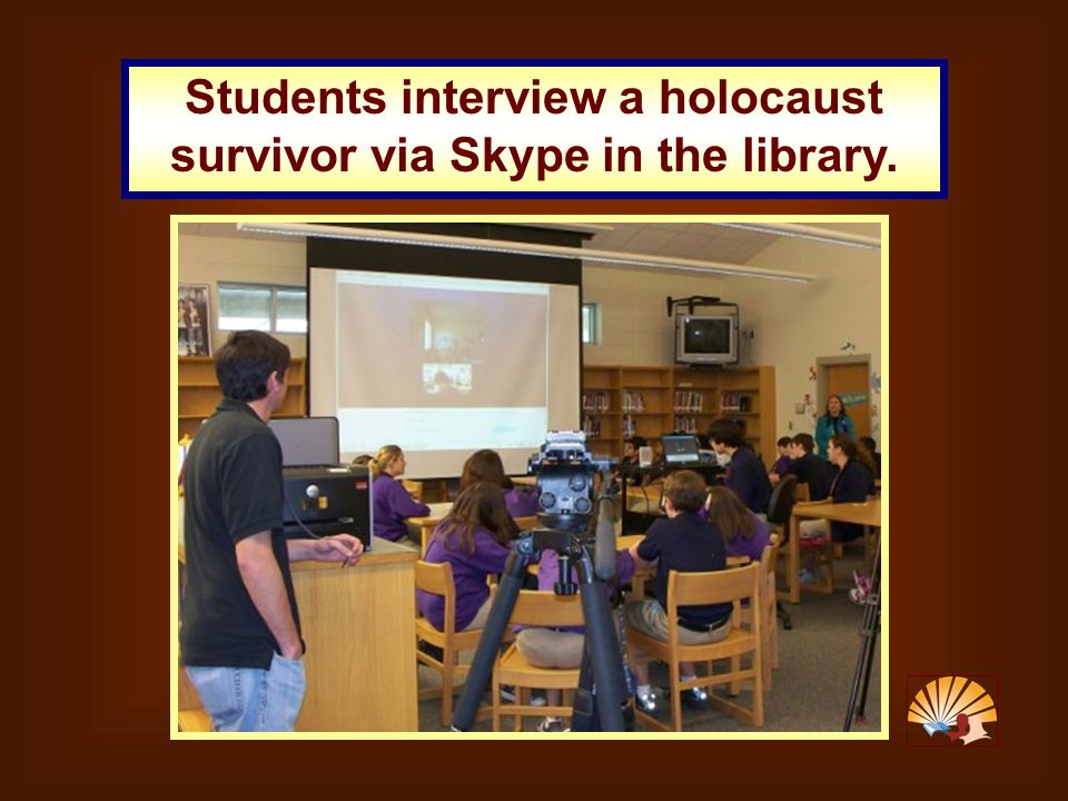 Students interview a holocaust survivor via Skype in the library.