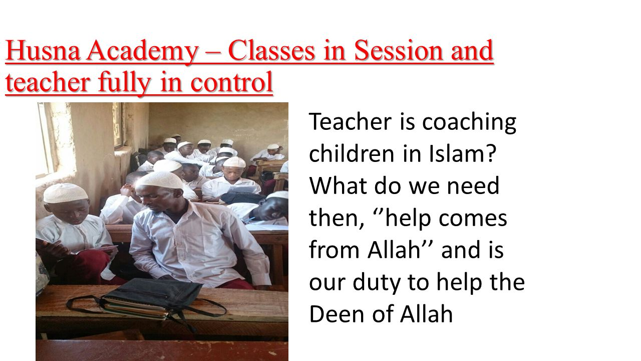 Husna Academy – Classes in Session and teacher fully in control Teacher is coaching children in Islam.
