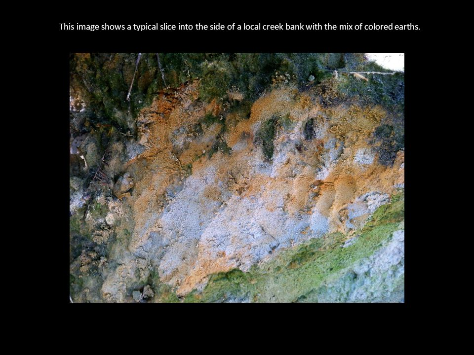 This image shows a typical slice into the side of a local creek bank with the mix of colored earths.