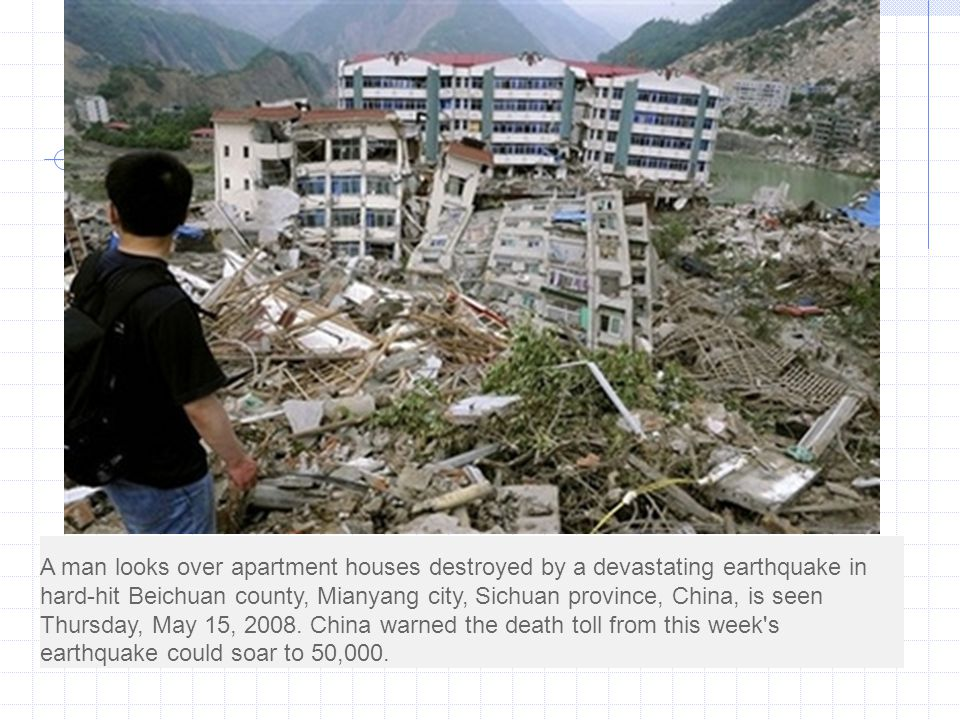 A man looks over apartment houses destroyed by a devastating earthquake in hard-hit Beichuan county, Mianyang city, Sichuan province, China, is seen Thursday, May 15, 2008.