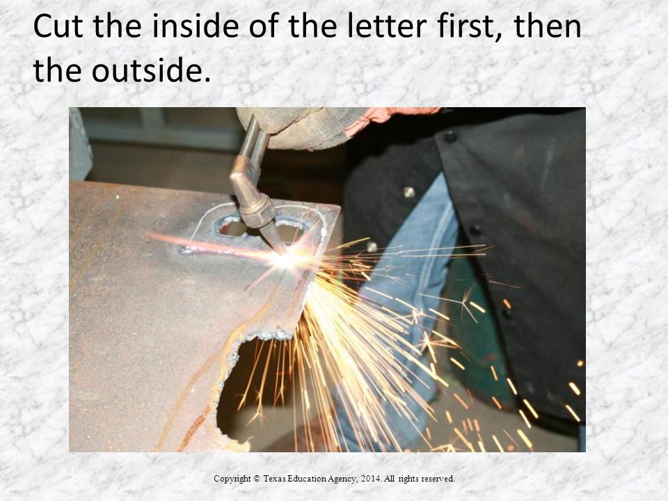 Cut the inside of the letter first, then the outside.