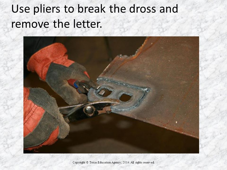 Use pliers to break the dross and remove the letter.