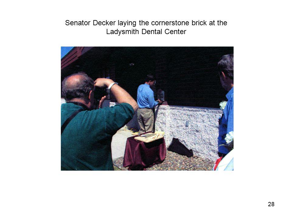 28 Senator Decker laying the cornerstone brick at the Ladysmith Dental Center