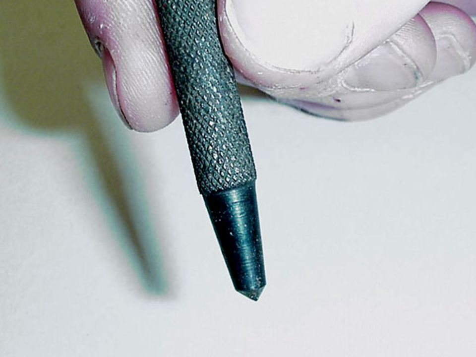 Drilling Metal Using a center punch and ball peen hammer to dent the metal to prevent the drill bit from wandering from the desired location