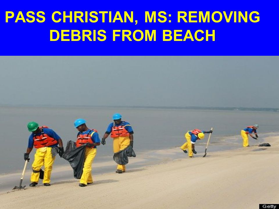PASS CHRISTIAN, MS: REMOVING DEBRIS FROM BEACH