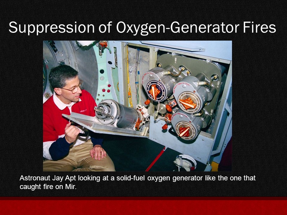 Suppression of Oxygen-Generator Fires Astronaut Jay Apt looking at a solid-fuel oxygen generator like the one that caught fire on Mir.