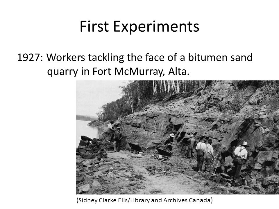 First Experiments 1927: Workers tackling the face of a bitumen sand quarry in Fort McMurray, Alta. (Sidney Clarke Ells/Library and Archives Canada)