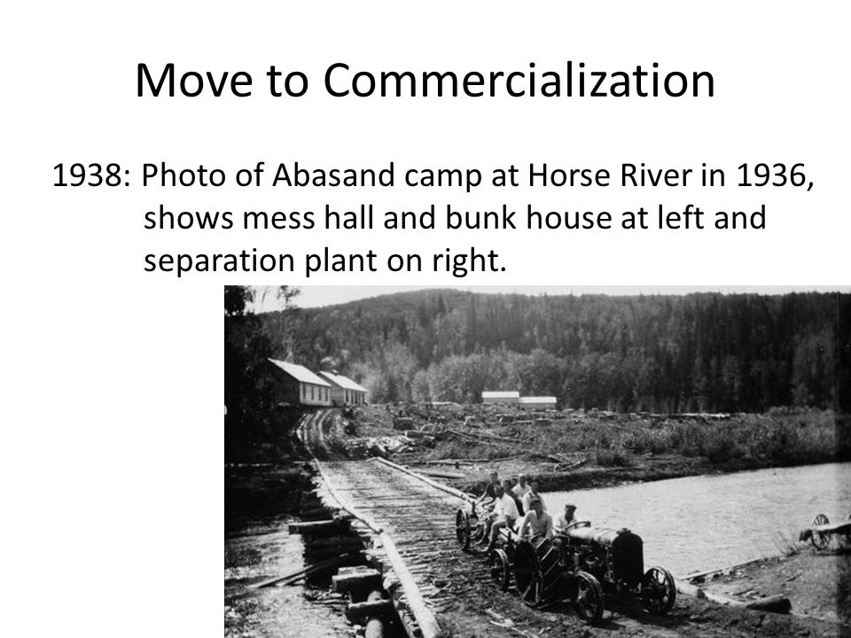 Move to Commercialization 1938: Photo of Abasand camp at Horse River in 1936, shows mess hall and bunk house at left and separation plant on right.