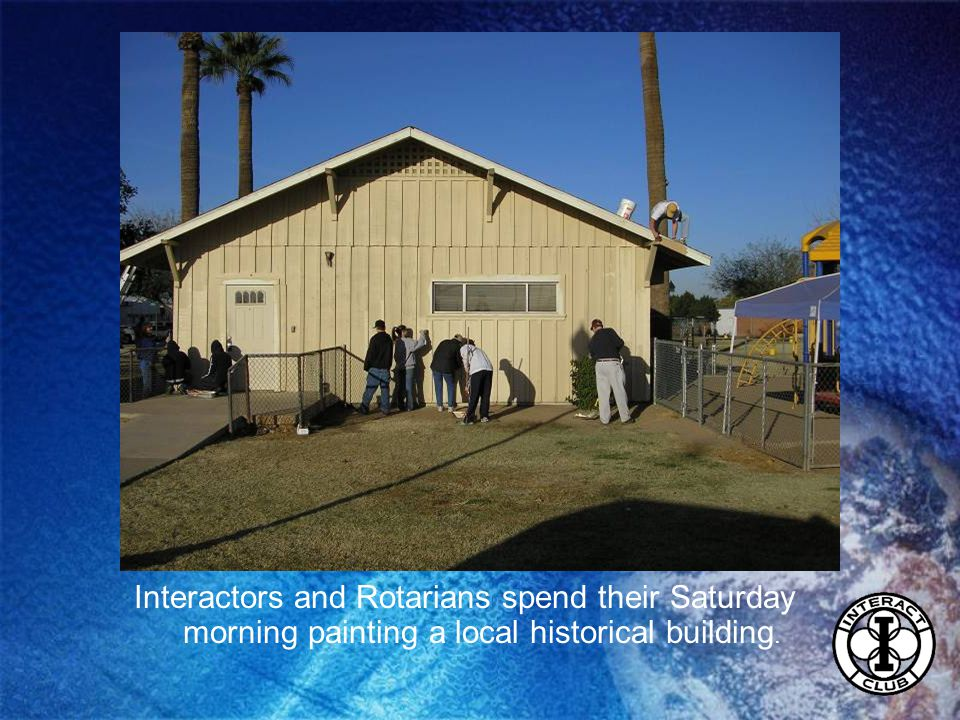 Interactors and Rotarians spend their Saturday morning painting a local historical building.
