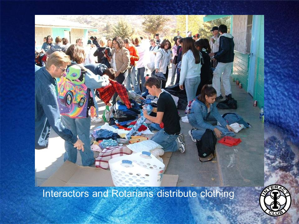 Interactors and Rotarians distribute clothing