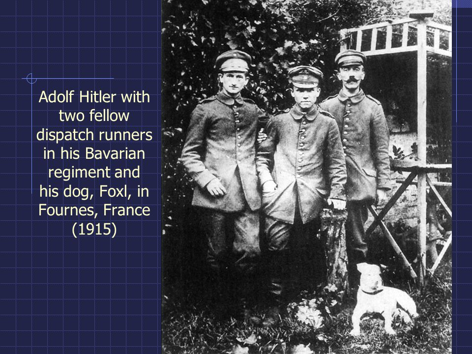 Adolf Hitler with two fellow dispatch runners in his Bavarian regiment and his dog, Foxl, in Fournes, France (1915)