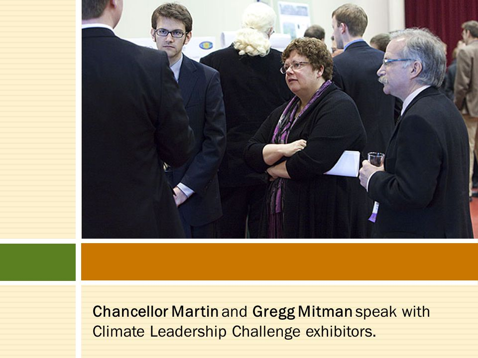 Chancellor Martin and Gregg Mitman speak with Climate Leadership Challenge exhibitors.
