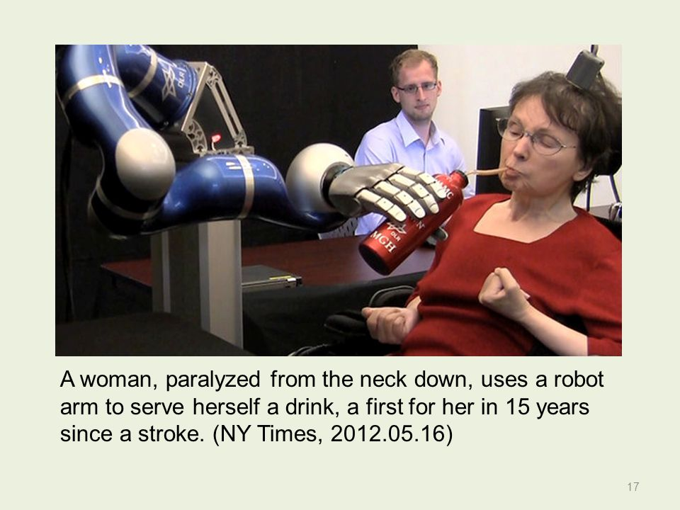 A woman, paralyzed from the neck down, uses a robot arm to serve herself a drink, a first for her in 15 years since a stroke.