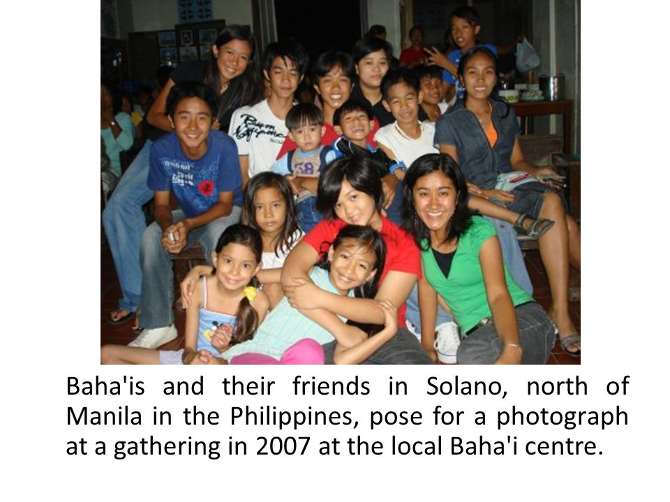 Baha is and their friends in Solano, north of Manila in the Philippines, pose for a photograph at a gathering in 2007 at the local Baha i centre.