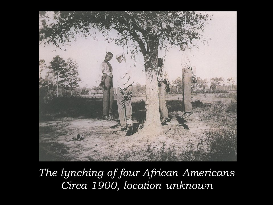 The lynching of four African Americans Circa 1900, location unknown