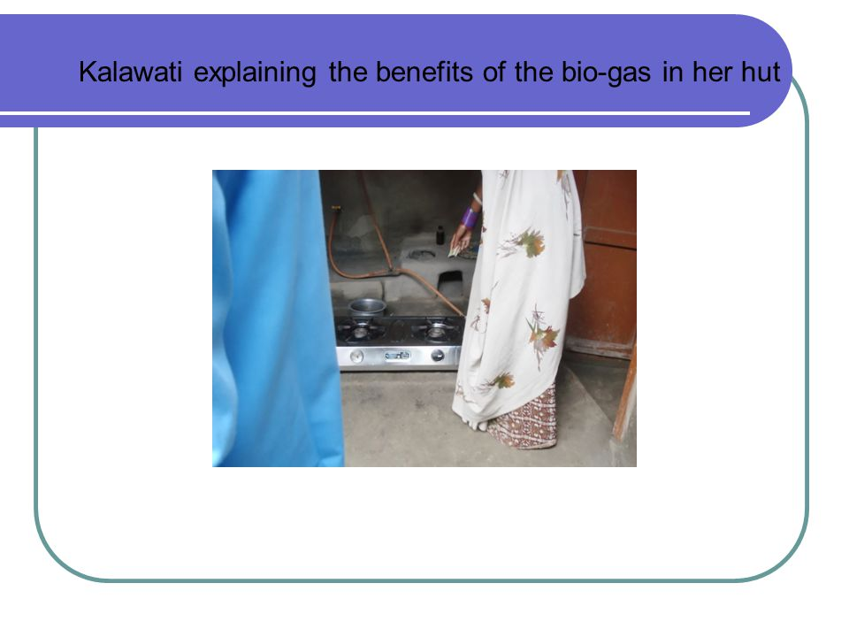 Kalawati explaining the benefits of the bio-gas in her hut