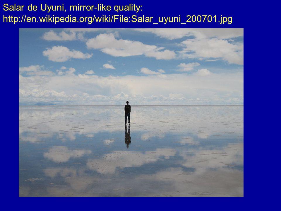 Salar de Uyuni, mirror-like quality: http://en.wikipedia.org/wiki/File:Salar_uyuni_200701.jpg