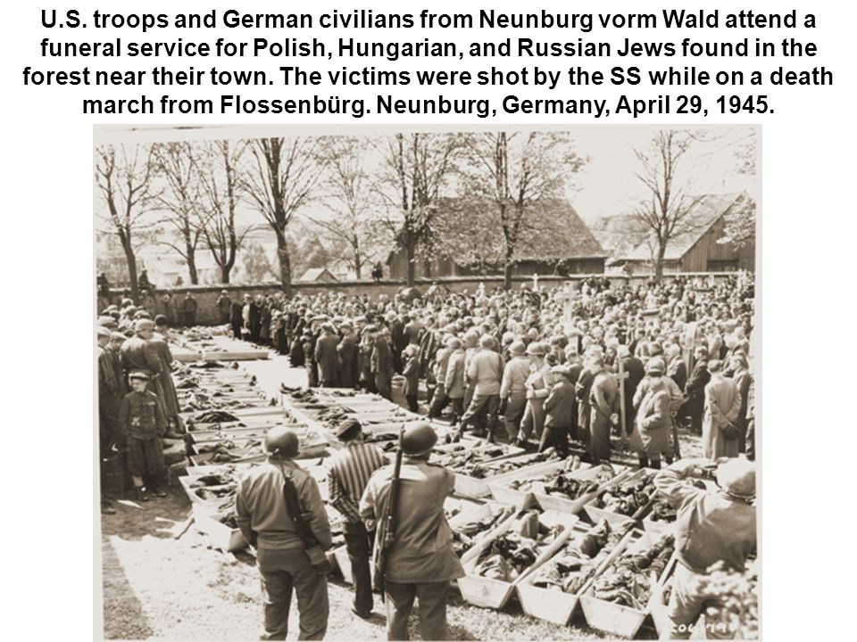 U.S. troops and German civilians from Neunburg vorm Wald attend a funeral service for Polish, Hungarian, and Russian Jews found in the forest near the