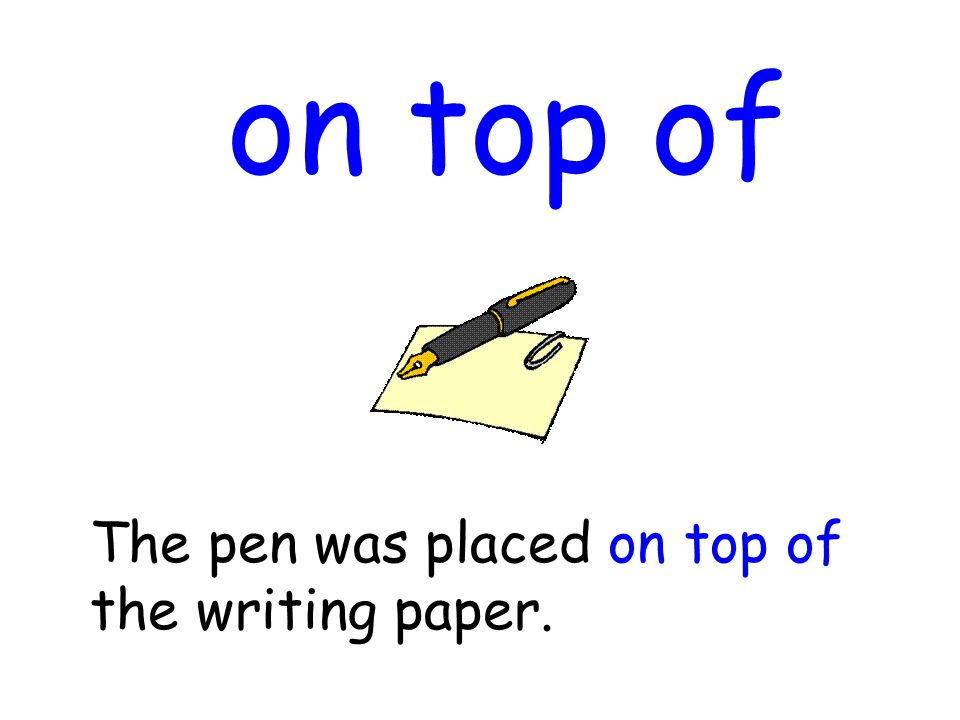 on top of The pen was placed on top of the writing paper.