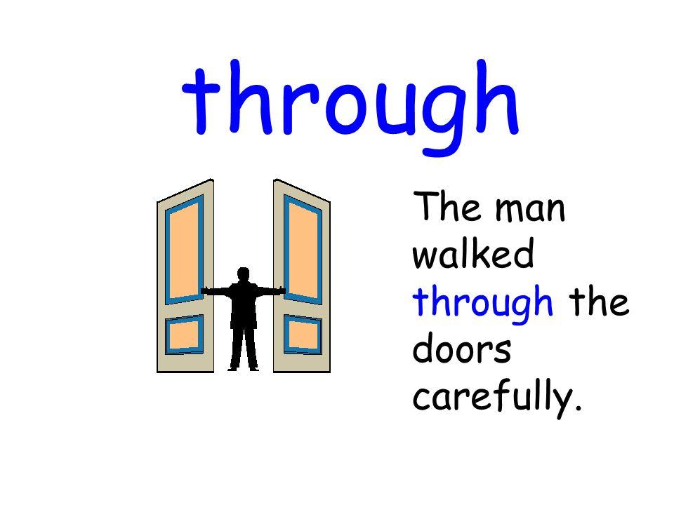 through The man walked through the doors carefully.