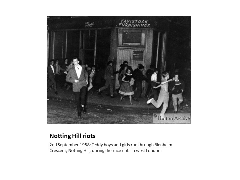Notting Hill riots 2nd September 1958: Teddy boys and girls run through Blenheim Crescent, Notting Hill, during the race riots in west London.