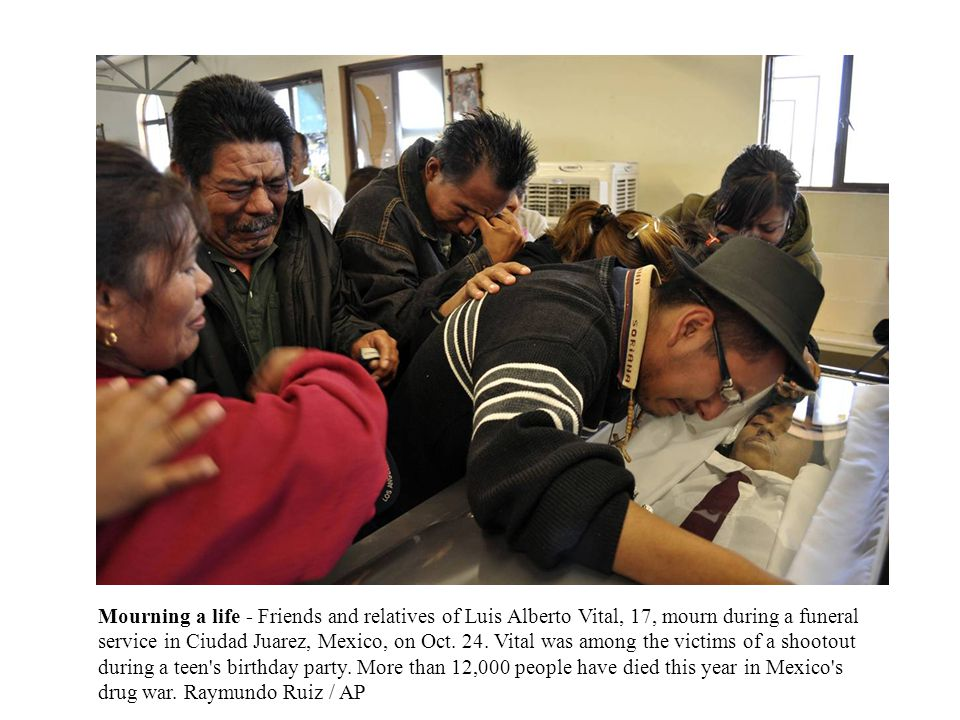 Mourning a life - Friends and relatives of Luis Alberto Vital, 17, mourn during a funeral service in Ciudad Juarez, Mexico, on Oct.