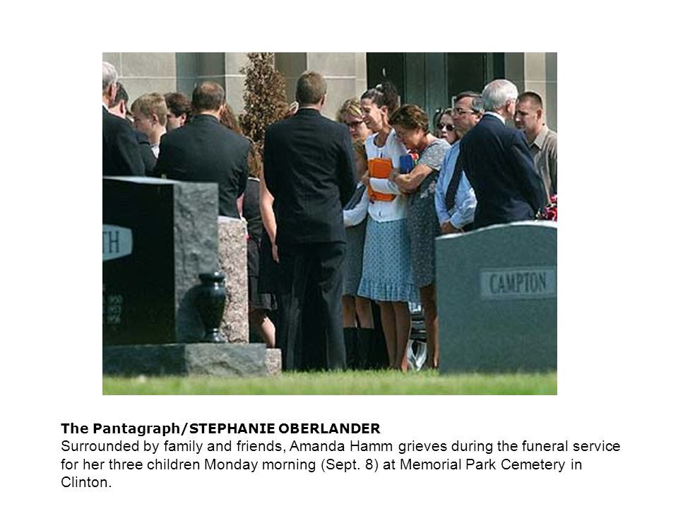 The Pantagraph/STEPHANIE OBERLANDER Surrounded by family and friends, Amanda Hamm grieves during the funeral service for her three children Monday morning (Sept.