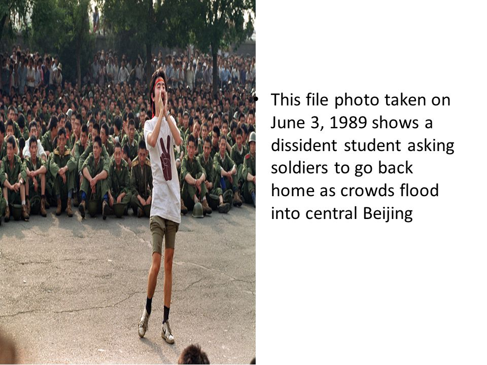 This file photo taken on June 3, 1989 shows a dissident student asking soldiers to go back home as crowds flood into central Beijing