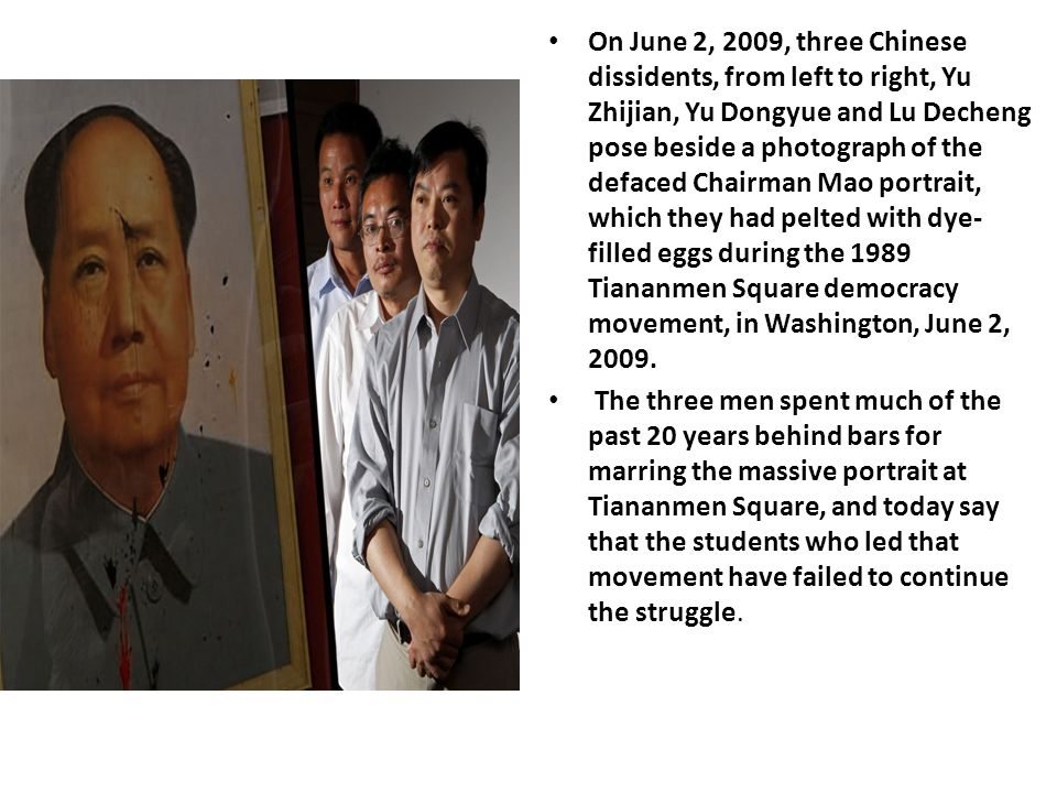 On June 2, 2009, three Chinese dissidents, from left to right, Yu Zhijian, Yu Dongyue and Lu Decheng pose beside a photograph of the defaced Chairman Mao portrait, which they had pelted with dye- filled eggs during the 1989 Tiananmen Square democracy movement, in Washington, June 2, 2009.