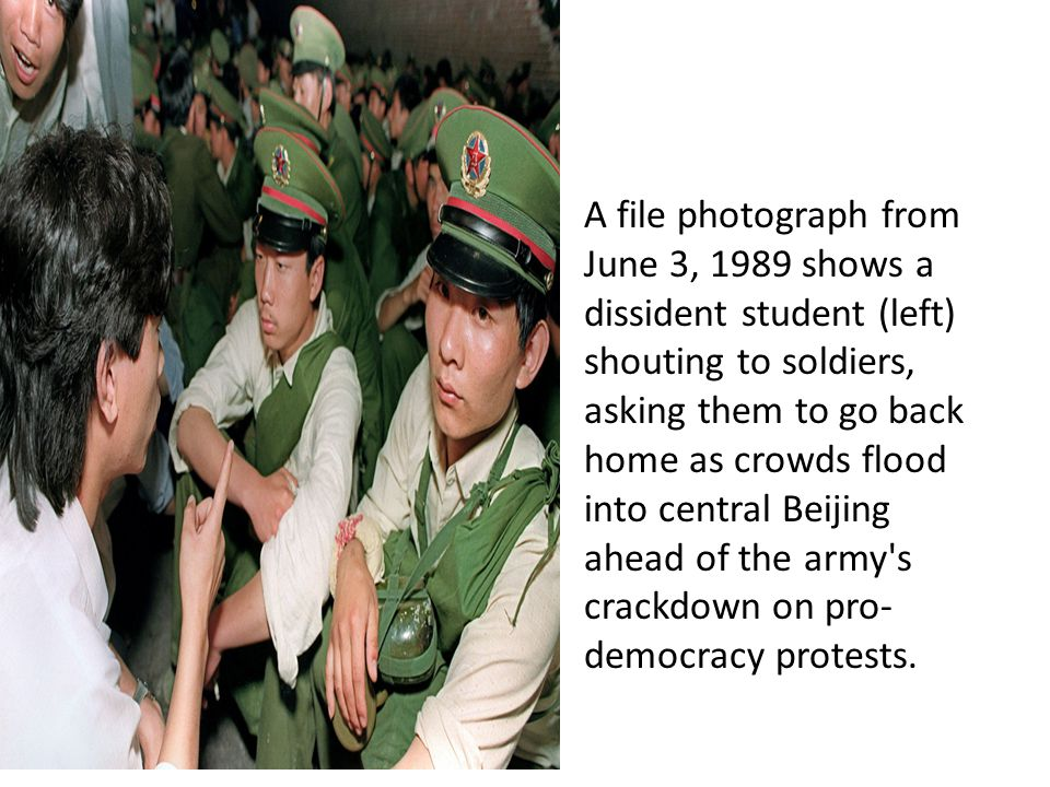 A file photograph from June 3, 1989 shows a dissident student (left) shouting to soldiers, asking them to go back home as crowds flood into central Beijing ahead of the army s crackdown on pro- democracy protests.