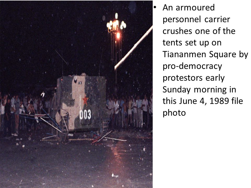 An armoured personnel carrier crushes one of the tents set up on Tiananmen Square by pro-democracy protestors early Sunday morning in this June 4, 198