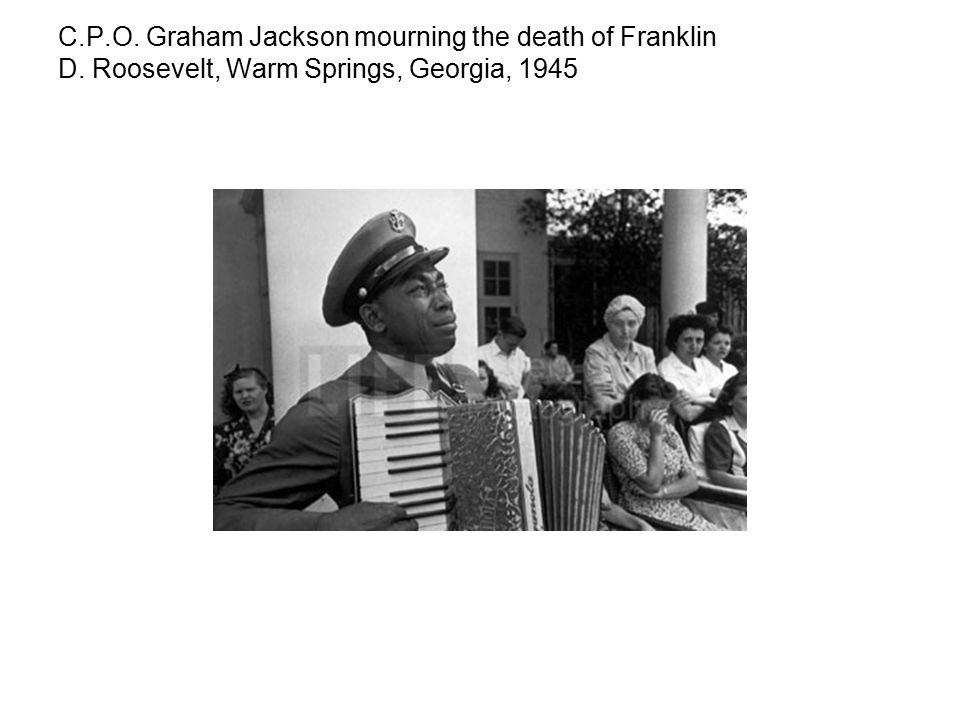 C.P.O. Graham Jackson mourning the death of Franklin D. Roosevelt, Warm Springs, Georgia, 1945