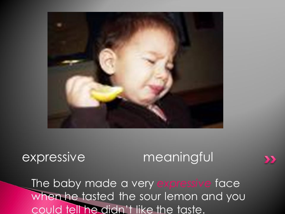 The baby made a very expressive face when he tasted the sour lemon and you could tell he didn't like the taste.