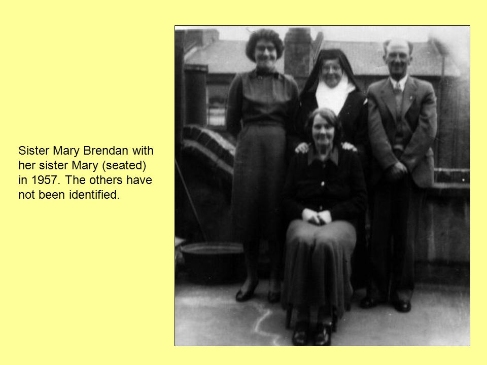 Sister Mary Brendan with her sister Mary (seated) in 1957. The others have not been identified.