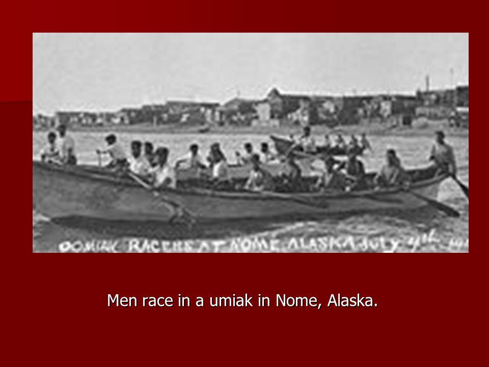 Men race in a umiak in Nome, Alaska.