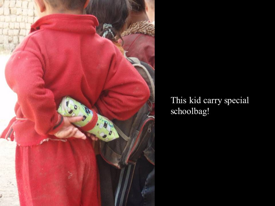 This kid carry special schoolbag!