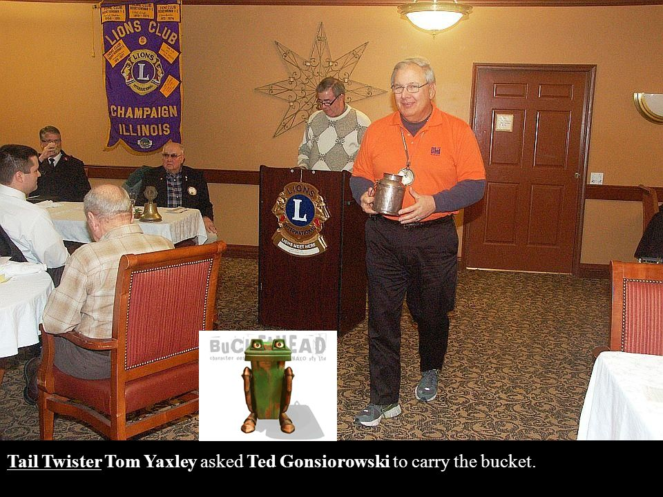 Tail Twister Tom Yaxley asked Ted Gonsiorowski to carry the bucket.
